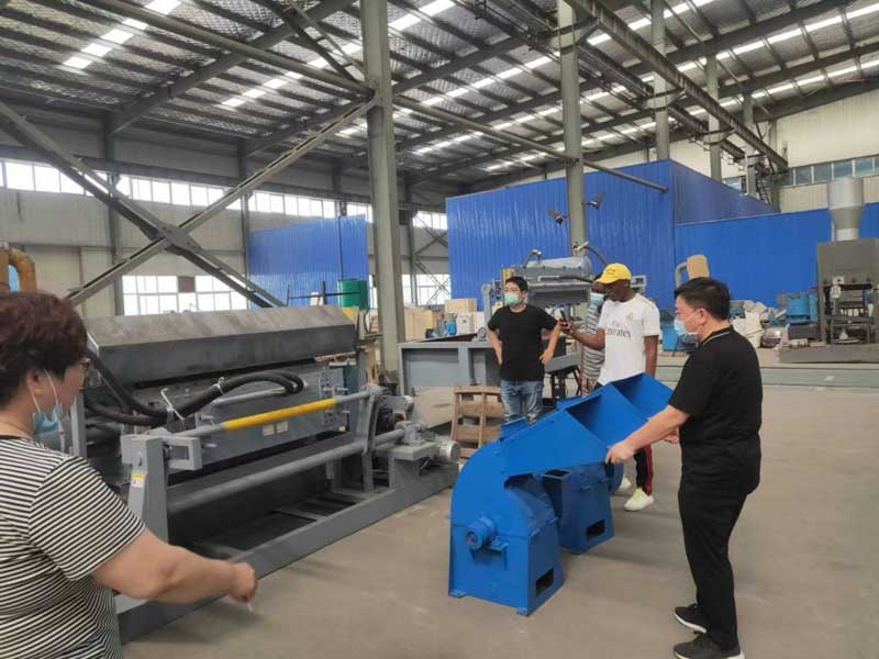 Clients visit egg tray machine factory
